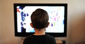 A boy watching television